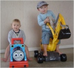 FGTL boys with their ride-on toys